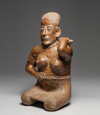 Figura femenina sentada.Figura femenina sentada