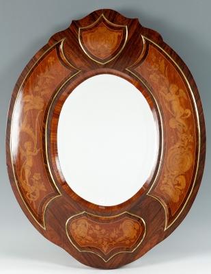 Espejo francés de finales del siglo XIXMadera de Jacaranda, marquetería de boj y bronce.Medidas: 79 x 62 x 3,5 cm.