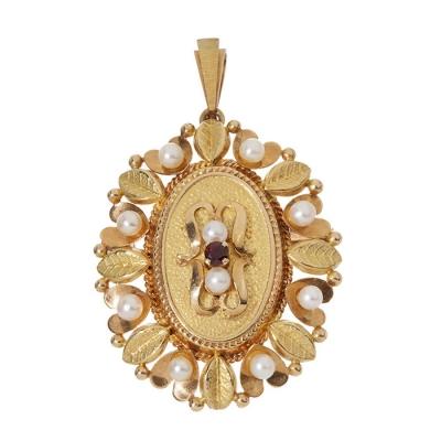 Broche-colgante en oro amarillo de 18 kts, años 60'.