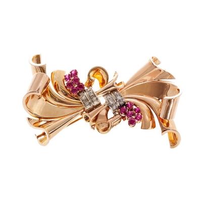 Broche doble-clip en oro amarillo de 18 kts. , ca