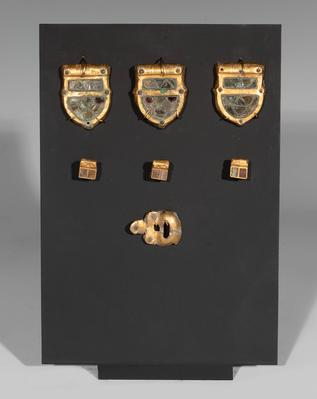 Belt buckle set. Europe, 6th-8th centuries ADGold and glass.