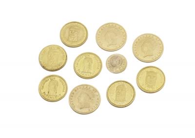Lote de diez monedas de oro amarillo.