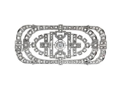 Platinum Art Deco brooch late. With geometric design plate, late Art Deco style, lined with brilliant cut diamonds and antique pink, color I, SI purity and ca.