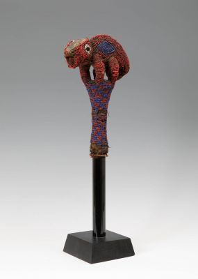 Royal Scepter and Lunga of Bamileke, Atuala'Kom, Cheferie de Mankon, Cameroon, first half of the 20th century.In carved wood, covered with beads.