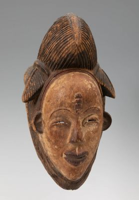 Okuyi mask, Punu, Gabon, first half of the 20th century.In carved wood.