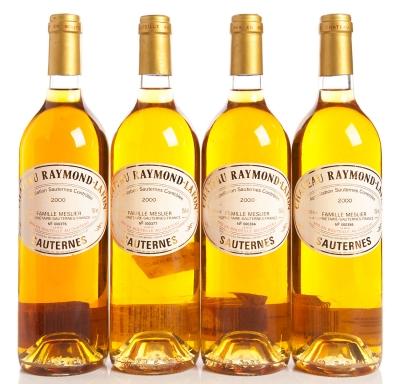 Cuatro botellas de Château Raymond-Lafon, cosecha del 2000.