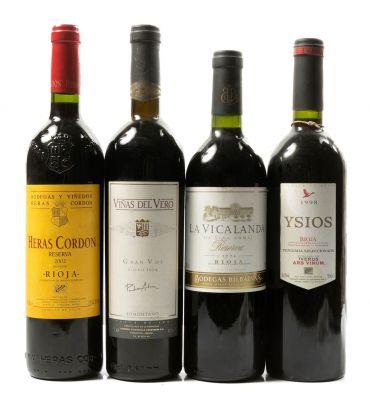 Selección de cuatro botellas Reserva,  una de Heras Cordon Reserva 2002,  Viñas del Vero Reserva 1994,  La Vicalanda de Viña Pomar,..