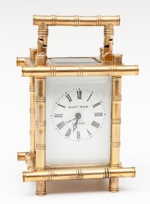 Reloj ELLIOTT & SON de sobremesa/ despertador. Metal