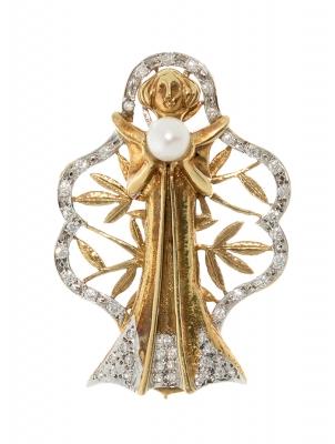 Broche realizado en oro blanco y oro amarillo de 18kts....