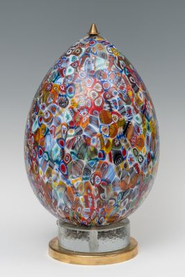 Egg lamp; second half of the 20th century.Murano glass and brass footMeasures: 54 x 17 cm.