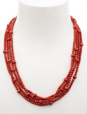 Collar largo de coral, con bolas regulares de 8/4 mm de diámetro.