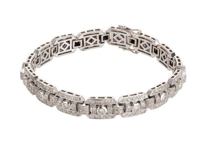 White gold bracelet 18 Kts with 15 steele with 270 diamonds brilliant cut and other 15, total weight 3,03 ctesWeight: 37,40 grMeasures: width 9 mm, largo 20 cm..