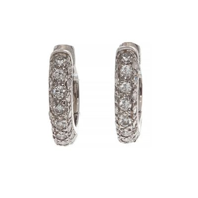 Pair of creole earrings in white gold. Ornamented in its center by pavé diamonds set, with a total of 0.