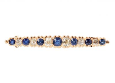 Bar clasp in 18K yellow gold, decorated with diamonds and sapphires decreasing towards the sides. six antique brilliant cut diamonds with different weights of 0.