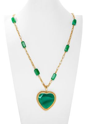 Yellow gold necklace of 18 kts. Oval chain with ten 16 x 8 mm crisopa beads and heart pendant of crisopas with beveled siege and spiral of 49 x 60 mm.