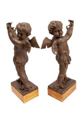 Pareja de ángeles decorativos, s. XX.
